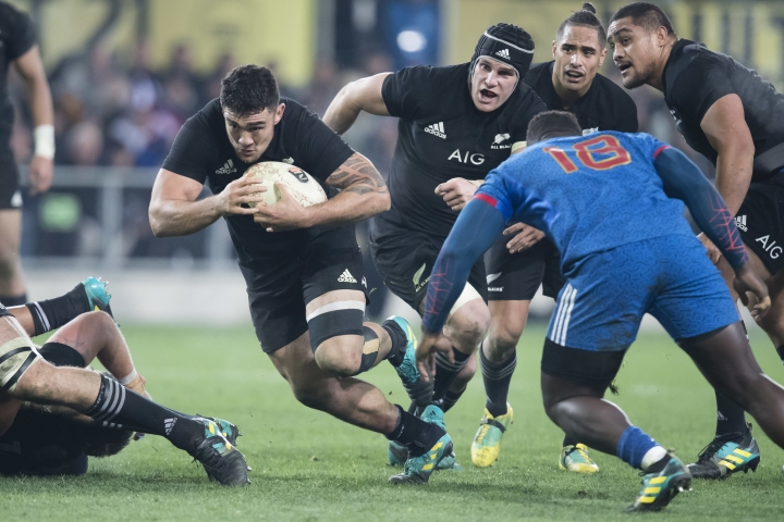 New Zealand's Codie Taylor, left, makes a run against France in the rugby test in Dunedin, New Zealand, Saturday, June 23, 2018. (AP Photo/Adam Binns)