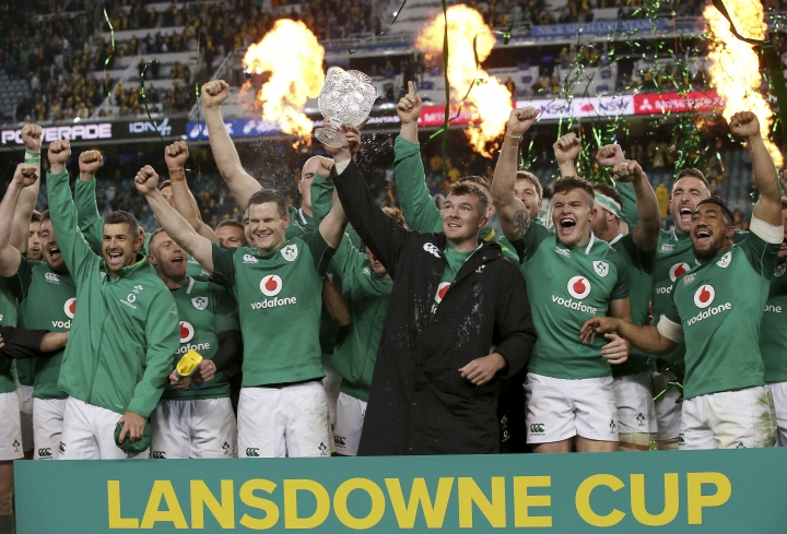 Ireland's Peter O'Mahony, center, holds up the Lansdowne Cup as he celebrates with teammates following their win over Australia intheir rugby union test match in Sydney, Saturday, June 23, 2018. Ireland won the series 2-1. (AP Photo/Rick Rycroft)