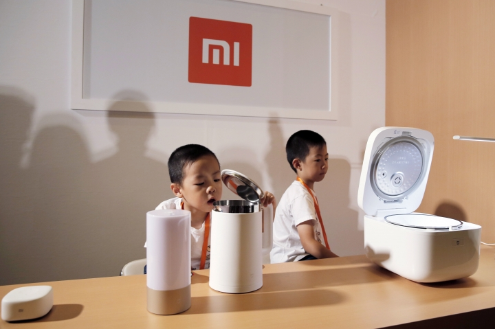 Xiaomi's products are displayed at a news conference in Hong Kong, Saturday, June 23, 2018. Xiaomi Corp. said it seeks to raise up to $6.1 billion in its initial public offering next week that would value the Chinese smartphone maker at as much as $70.3 billion. (AP Photo/Kin Cheung)