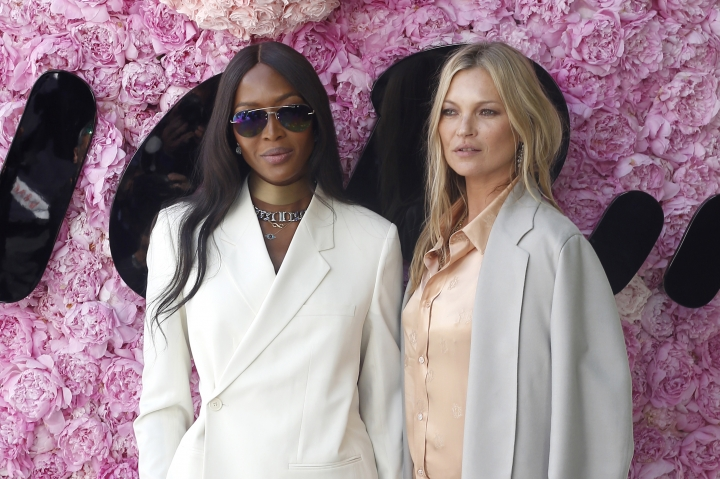 Models Kate Moss, right, and Naomi Campbell pose for photographers upon arrival at the Dior Men's Spring-Summer 2019 fashion collection presented in Paris, Saturday June 23, 2018. (AP Photo/Thibault Camus)