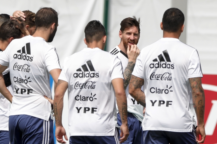 Lionel Messi and teammates gather at the center of the field at the start of a training session of Argentina at the 2018 soccer World Cup in Bronnitsy, Russia, Sunday, June 24, 2018. (AP Photo/Ricardo Mazalan)