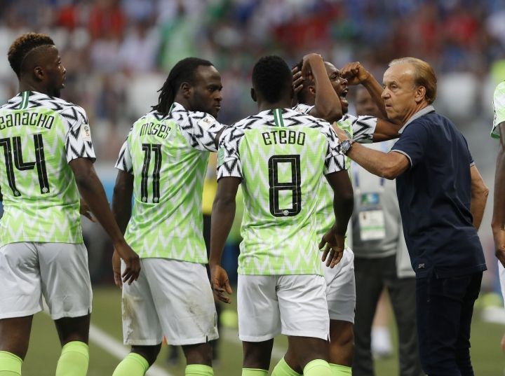 Nigeria head coach Gernot Rohr, right, talks with his players as they celebrate their first goal during the group D match between Nigeria and Iceland at the 2018 soccer World Cup in the Volgograd Arena in Volgograd, Russia, Friday, June 22, 2018. (AP Photo/Darko Vojinovic)