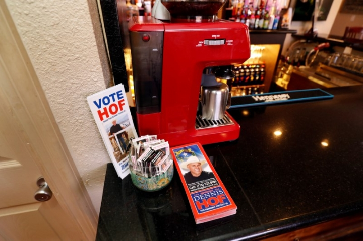 Campaign brochures are shown on the bar at the Love Ranch, a legal brothel owned by Dennis Hof, who recently won the Republican primary election for Nevada State Assembly District 36, in Crystal, Nevada, U.S. June 15, 2018. Picture taken June 15, 2018. REUTERS/Steve Marcus