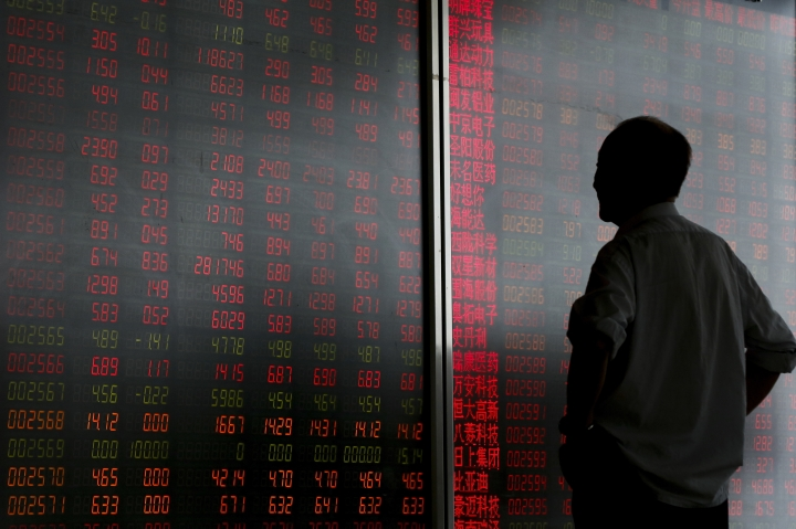 A man looks at an electronic board displaying stock prices at a brokerage house in Beijing, Monday, June 25, 2018.Asian stock markets fell Monday and oil prices gave up some of their gains after Chinese regulators freed up extra money for bank lending amid a trade dispute with Washington. (AP Photo/Andy Wong)