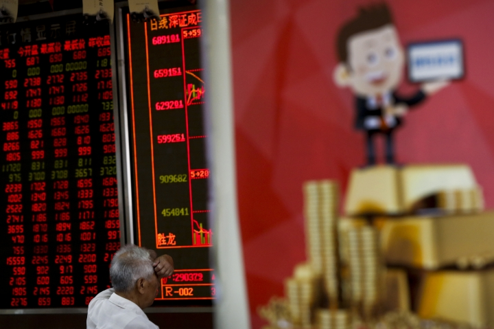 A man monitors stock prices at a brokerage house in Beijing, Monday, June 25, 2018. Asian stock markets fell Monday and oil prices gave up some of their gains after Chinese regulators freed up extra money for bank lending amid a trade dispute with Washington. (AP Photo/Andy Wong)