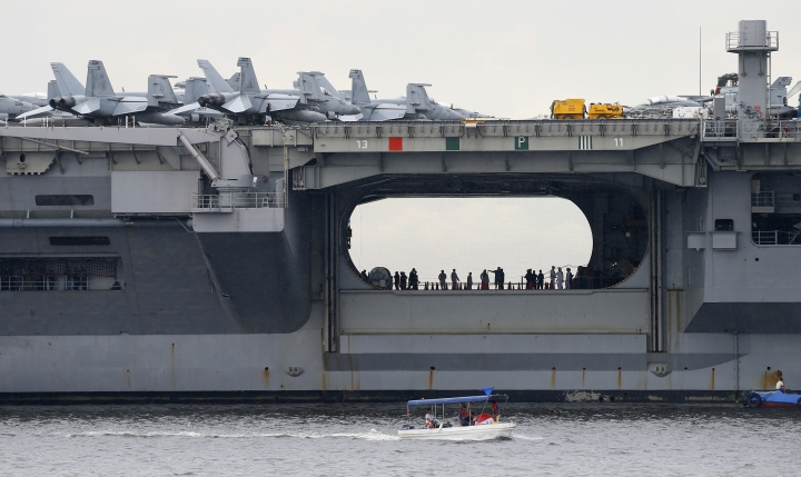 """Fighter jets are seen on the deck of the U.S. aircraft carrier USS Ronald Reagan (CVN 76) as it anchors off Manila Bay for a goodwill visit Tuesday, June 26, 2018 west of Manila, Philippines. The U.S. military has deployed the U.S. aircraft carrier to patrol the South China Sea """"to deter conflict and coercion"""" in a disputed region where Washington has moved against China's military buildup on manmade islands. (AP Photo/Bullit Marquez)"""