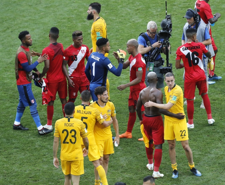 Peru team celebrate after their 2-0 win over Australia in the group C match between Australia and Peru, at the 2018 soccer World Cup in the Fisht Stadium in Sochi, Russia, Tuesday, June 26, 2018. (AP Photo/Efrem Lukatsky)