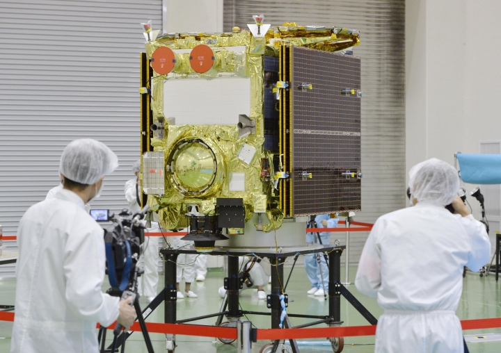 In this Aug. 31, 2014, photo, asteroid explorer Hayabusa2 is displayed to media by the Japan Aerospace Exploration Agency (JAXA) at its facility in Sagamihara, near Tokyo. The Japanese space explorer that will try to blow a crater in an asteroid and bring back samples from inside is nearing its destination after a 3 1/2 -year journey. The unmanned Hayabusa2 has arrived at the asteroid Wednesday, June 27, 2018, about 280 million kilometers (170 million miles) from Earth. (Kyodo News via AP)
