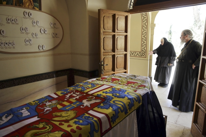 A Russian priest stands by the grave of Princess Alice of Battenberg and Greece, great-grandmother of Prince William, at the Mary Magdalene Church, in east Jerusalem, Wednesday, June 27, 2018. When William makes the pilgrimage to the tomb it will showcase one of the more unusual characters in royal history. The deaf, great-granddaughter of Queen Victoria saved Jews during World War II and her last wishes were to have her remains buried in a crypt below a Russian Orthodox church in east Jerusalem. (AP Photo/Mahmoud Illean)