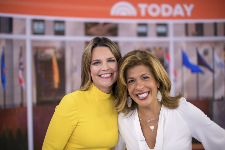 """""""Today"""" show co-anchors Savannah Guthrie, left, and Hoda Kotb pose on set at NBC Studios on Wednesday, June 27, 2018, in New York. NBC is marking six months with its new team of Savannah Guthrie and Hoda Kotb at the """"Today"""" show, a pairing made necessary by Matt Lauer's firing on sexual misconduct charges. (Photo by Charles Sykes/Invision/AP)"""