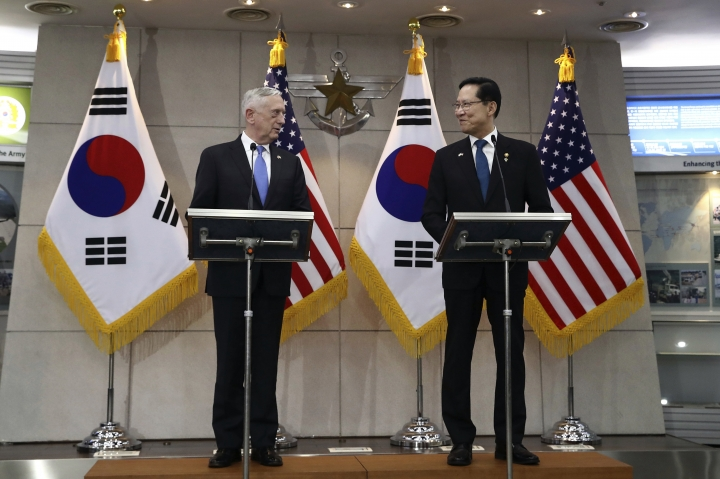 U.S. Defense Secretary Jim Mattis, left, and South Korean Defense Minister Song Young-moo speak in Seoul, South Korea Thursday, June 28, 2018. (Chung Sung-jun/Pool Photo via AP)