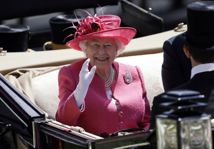 FILE - In this Thursday, June 21, 2018 file photo, Britain's Queen Elizabeth II arrives on the third day of the Royal Ascot horse race meeting, which is traditionally known as Ladies Day, in Ascot, England Thursday. Queen Elizabeth II is costing British taxpayers a bit more this year. Financial figures published Thursday, June 28, 2018 reveal that overall costs have gone up in part because of a 10-year program to refit aging Buckingham Palace, the queen's official residence in central London. (AP Photo/Tim Ireland. File)