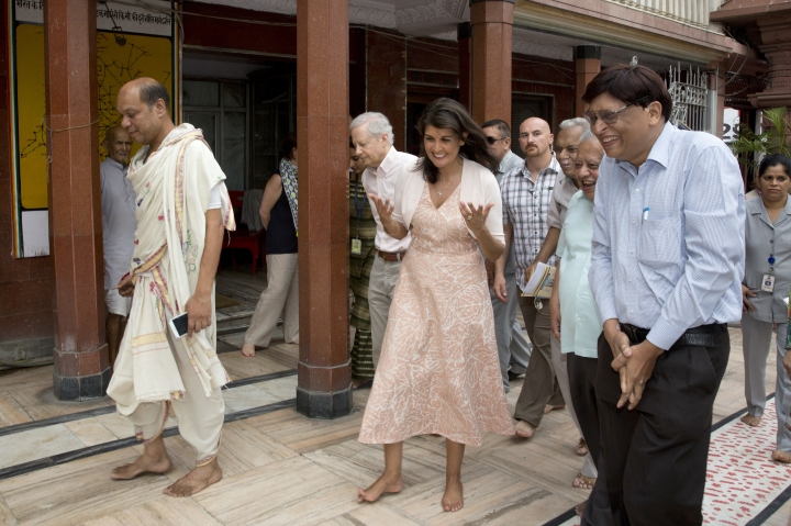 U.S. Ambassador to the United Nations Nikki Haley, center, talks to trustees and priest of Shri Digambar Jain Lal Mandir or temple in New Delhi, India, Thursday, June 28, 2018. Haley offered inter-faith prayers in New Delhi on Thursday, visiting a Sikh shrine, a Hindu temple, a Jain temple, a Church and a Muslim mosque in the old, walled area of the Indian capital. (AP Photo/Manish Swarup)