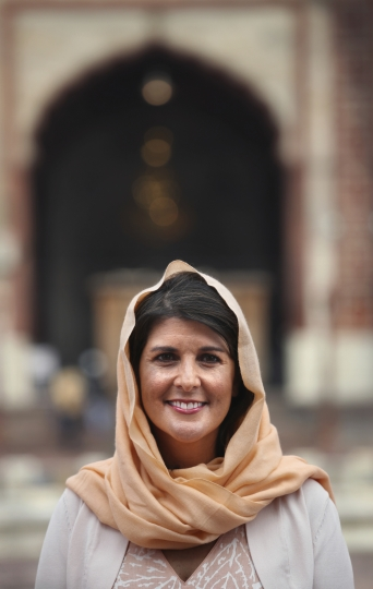 U.S. Ambassador to the United Nations Nikki Haley poses in front of Jama Masjid or mosque in New Delhi, India, Thursday, June 28, 2018. Nikki Haley offered inter-faith prayers in New Delhi on Thursday, visiting a Sikh shrine, a Hindu temple, a Jain temple, a Church and a Muslim mosque in the old, walled area of the Indian capital. The United States on Wednesday announced postponement of a high-level dialogue with India scheduled for next week in Washington, D.C., without assigning any reasons even as its ambassador to the United Nations met with top Indian leaders in New Delhi to step up ties in various fields. (AP Photo/Manish Swarup)