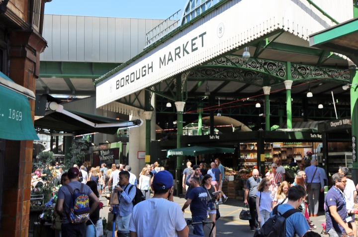 In this photo taken on Wednesday, June 27, 2018, people visit Borough Market in London. Seven historic food and drink markets are creating an alliance to promote the sale of local produce. London's Borough Market said Thursday, June 28, 2018 it will partner with La Boqueria in Barcelona, Markthalle Neun in Berlin, Central Market Hall in Budapest, Sydney Fish Market in Sydney, Queen Victoria Market in Melbourne, and Pike Place Market in Seattle. (AP Photo/Robert Stevens)