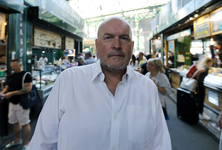 In this photo taken on Wednesday, June 27, 2018, Donald Hyslop, Chair of Trustees at Borough Market, speaks to the Associated Press in Borough Market in London. Seven historic food and drink markets are creating an alliance to promote the sale of local produce. London's Borough Market said Thursday, June 28, 2018 it will partner with La Boqueria in Barcelona, Markthalle Neun in Berlin, Central Market Hall in Budapest, Sydney Fish Market in Sydney, Queen Victoria Market in Melbourne, and Pike Place Market in Seattle. (AP Photo/Robert Stevens)