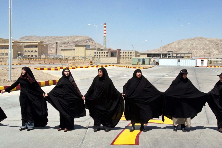 "FILE - In this Aug. 16, 2005 file photo, Iranian women form a human chain, at the Isfahan Uranium Conversion Facility, in support of Iran's nuclear program, just outside the city of Isfahan, Iran, 410 kilometers (255 miles) south of the capital Tehran. Iran says it restarted the production facility in Isfahan, a ""major"" uranium facility involved in its nuclear program, but still pledges to follow the terms of its atomic deal now threatened by President Donald Trump pulling America from the accord. (AP Photo/Vahid Salemi, File)"