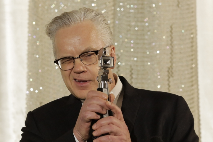 FILE - In this Saturday, Feb. 13, 2016 file photo, actor and director Tim Robbins poses with his Berlinale Camera Award after he is honored for his lifetime achievement at the 2016 Berlinale Film Festival in Berlin. An annual international film festival in the Czech spa of Karlovy Vary is kicking off with an award for American actor, director, and producer Tim Robbins. (AP Photo/Markus Schreiber, File)