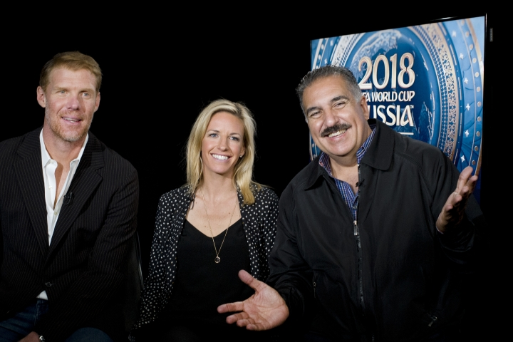 Alexi Lalas, left, Aly Wagner and Fernando Fiore talk during an interview, Wednesday, May 30, 2018, in New York. They will be part of Fox Sports coverage of the 2018 FIFA World Cup. Fox's Aly Wagner and Telemundo's Viviana Vila are the first in-match analysts on U.S. broadcast television for soccer's showcase, the FIFA World Cup. BBC's Vicki Sparks is making a similar breakthrough in Britain, as is ZDF's Claudia Neumann in Germany. Meanwhile, Kate Abdo is Fox's start-of-the-day studio show anchor in Red Square (AP Photo/Mark Lennihan)