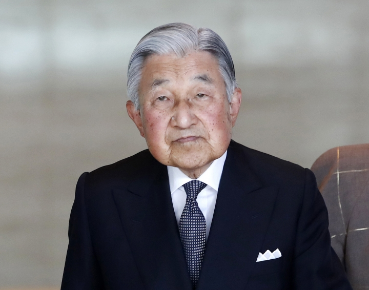 FILE - In this May 30, 2018, file photo, Japan's Emperor Akihito walks on his way to welcome Vietnamese President Tran Dai Quang and his wife Nguyen Thi Hien at the Imperial Palace in Tokyo. Japanese Emperor Akihito is feeling nauseous and dizzy from cerebral anemia, a condition caused by insufficient blood flow to the brain, and he has canceled or postponed his duties, according to the Imperial Household Agency on Monday, July 2, 2018. (Franck Robichon/Pool Photo via AP, File)