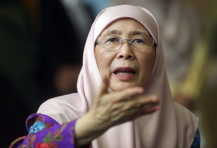 "Malaysian Deputy Prime Minister Wan Azizah Wan Ismail speaks during a government event in Putrajaya, Malaysia on Monday, July 2, 2018. Malaysian authorities are investigating the marriage between an 11-year-old girl and a 41-year-old Malaysian Muslim, including elements of possible ""sexual grooming"" in the case, Deputy Prime Minister Wan Azizah Wan Ismail said Monday. (AP Photo)"