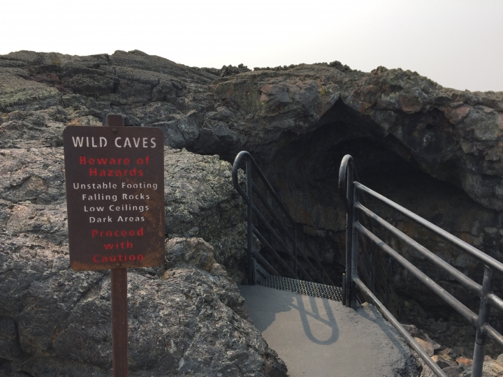 This Sept. 7, 2017 photo shows a cave entrance at Craters of the Moon National Monument and Preserve in Arco, Idaho. The caves are actually tubes created by flowing lava that later cooled. Visitors may enter the caves but they must obtain permits from the park's visitor center and they're required to carry a flashlight. (AP Photo/Beth J. Harpaz)
