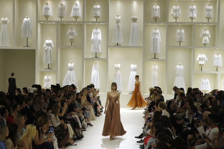 Models wears creations for Dior Haute Couture Fall-Winter 2018/2019 fashion collection presented Monday, July 2, 2018 in Paris. (AP Photo/Francois Mori)