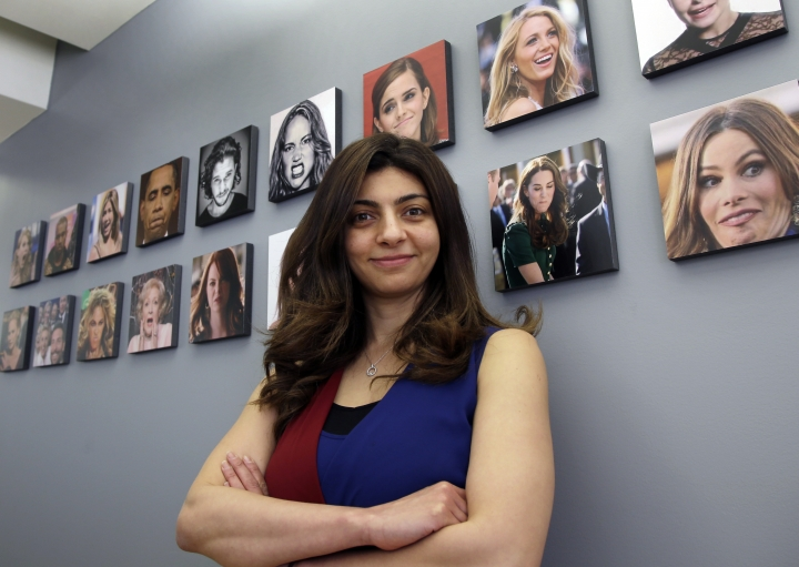 In this April 23, 2018, photo, Rana el Kaliouby, CEO of the Boston-based artificial intelligence firm, Affectiva, poses in Boston. Affectiva builds face-scanning technology for detecting emotions, but its founders decline business opportunities that involve spying on people. (AP Photo/Elise Amendola)