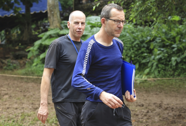 Richard Stanton, left, and John Volanthen arrive in Mae Sai, Chiang Rai province, in northern Thailand, Tuesday, July 3, 2018. The 12 boys and soccer coach found in a partially flooded cave in northern Thailand after 10 days are mostly in stable medical condition and have received high-protein liquid food, officials said Tuesday, though it is not known when they will be able to go home. (AP Photo)