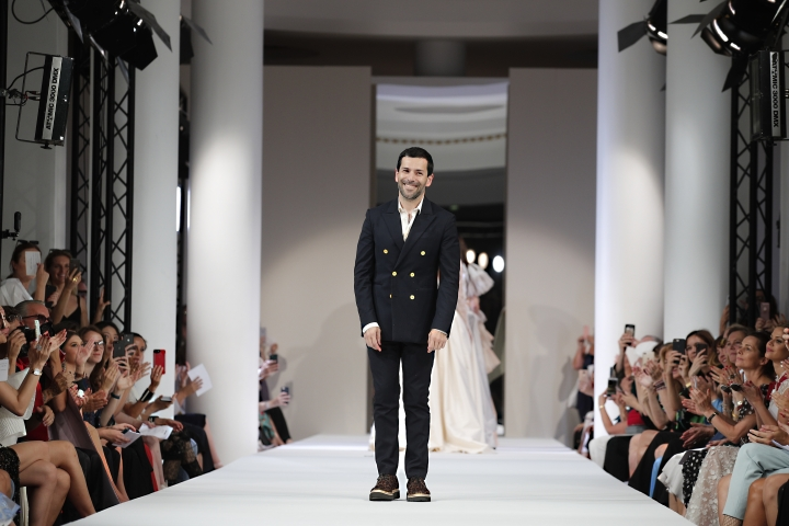 Designer Alexis Mabille accepts applause after the Mabille Haute Couture Fall-Winter 2018/2019 fashion collection presented Tuesday, July 3, 2018 in Paris. (AP Photo/Francois Mori)