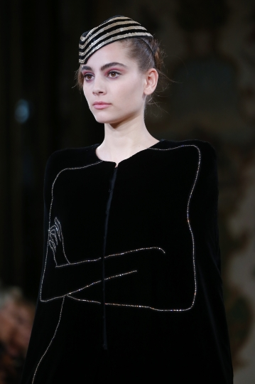 A model wears a creation for the Armani Haute Couture Fall-Winter 2018/2019 fashion collection presented Tuesday, July 3, 2018 in Paris. (AP Photo/Michel Euler)