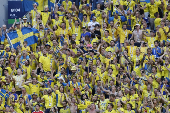 Sweden fans celebrate on the stand at the end of the round of 16 match between Switzerland and Sweden at the 2018 soccer World Cup in the St. Petersburg Stadium, in St. Petersburg, Russia, Tuesday, July 3, 2018. Sweden won 1-0. (AP Photo/Darko Bandic)