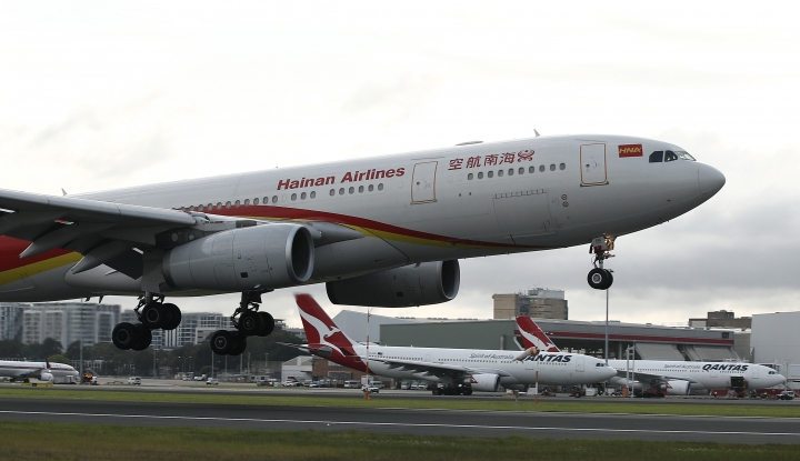 FILE - In this Sept. 13, 2016, file photo, Hainan Airlines' new service from Changsha to Sydney touches down for the first time at Sydney Airport in Australia. Chinese conglomerate HNA Group, which operates Hainan Airlines and other businesses around the world, said Wednesday, July 4, 2018, that its co-chairman has died while on a business trip in France. (AP Photo/Rob Griffith, File)