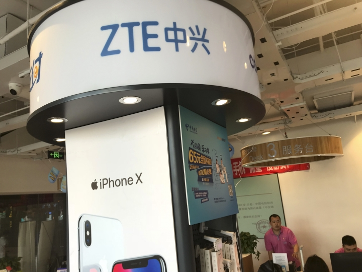 ZTE's logo is seen in a telecommunication services shop in Beijing Wednesday, July 4, 2018. Tech giant ZTE Corp.'s near-death experience after Washington barred it from buying U.S. components was a stark reminder that China's industry leaders cannot function without American technology. (AP Photo/Ng Han Guan)