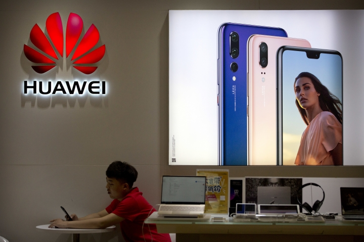 A sales clerk looks at his smartphone in a Huawei store at a shopping mall in Beijing Wednesday, July 4, 2018. China has produced success stories including Huawei Technologies Ltd., the biggest global seller of switching gear for phone companies and the No. 3 smartphone brand. The company has developed its own Kirin line of chip sets to power some of its phones, reducing reliance on U.S.-based Qualcomm Corp.'s Snapdragon and other foreign suppliers. (AP Photo/Mark Schiefelbein)