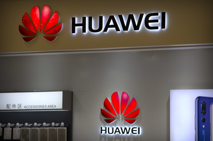 Huawei logos are seen at a Huawei store at a shopping mall in Beijing Wednesday, July 4, 2018. China has produced success stories including Huawei Technologies Ltd., the biggest global seller of switching gear for phone companies and the No. 3 smartphone brand. The company has developed its own Kirin line of chip sets to power some of its phones, reducing reliance on U.S.-based Qualcomm Corp.'s Snapdragon and other foreign suppliers. (AP Photo/Mark Schiefelbein)