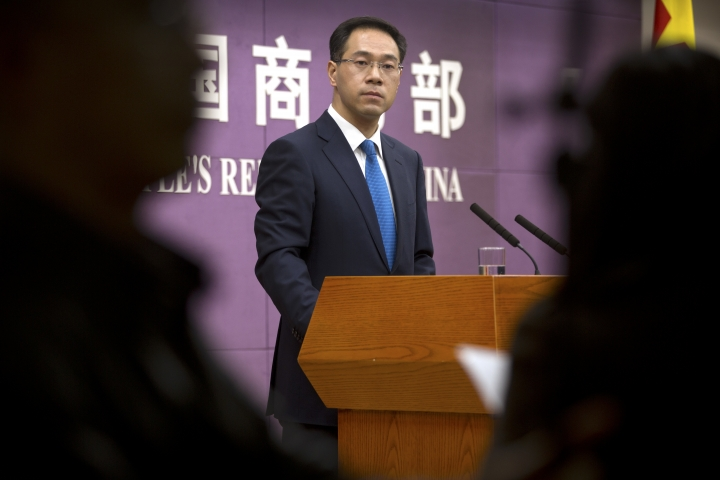 """In this March 29, 2018, photo, Chinese Ministry of Commerce spokesman Gao Feng listens to a reporter's question during a press conference at the Ministry of Commerce in Beijing. A Chinese government spokesman has said Thursday, July 5, 2018, that Beijing """"will not bow in the face of threats and blackmail"""" on the eve of U.S. tariff hikes and will defend its interests. (AP Photo/Mark Schiefelbein)"""
