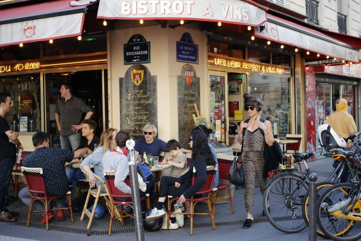"""In this photo taken on Monday, June 25, 2018, Parisians relax on a terrace at """"Le Reveil du Xth"""" restaurant, in Paris. Paris' bistros and terraces have formed an association of bistros owners to launch a campaign to be recognized by the United Nations' cultural agency UNESCO as a French way of life with """"intangible cultural heritage"""" status. (AP Photo/Francois Mori)"""