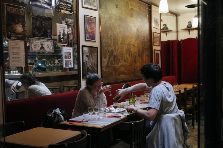 "In this photo taken on Monday, June 25, 2018, a couple attend a romantic diner at ""La Cave a Jojo"" restaurant in Montmartre district, in Paris. Paris' bistros and terraces have formed an association of bistros owners to launch a campaign to be recognized by the United Nations' cultural agency UNESCO as a French way of life with ""intangible cultural heritage"" status. (AP Photo/Francois Mori)"