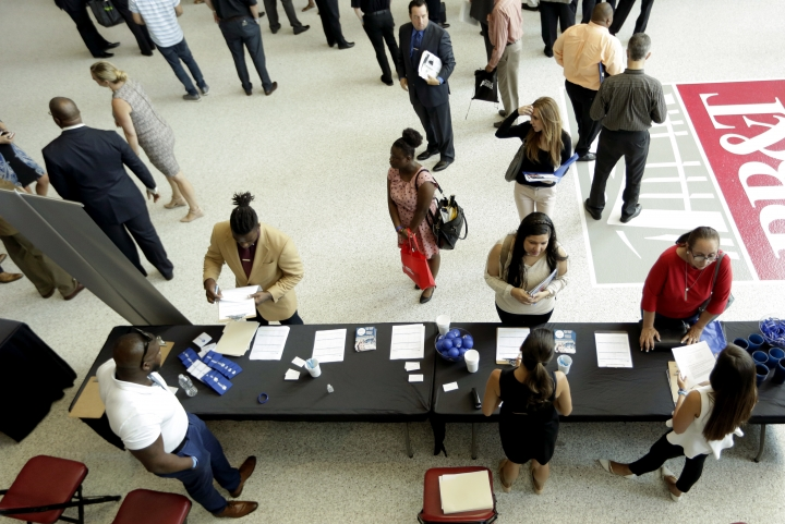 In this Thursday, June 21, 2018 photo, job applicants talk with representatives from Custom Services at a job fair hosted by Job News South Florida, in Sunrise, Fla. A private survey shows that American businesses added 177,000 workers in June, a sign of health and resilience for the U.S. labor market and economy. Payroll processor ADP said Thursday, July 5, that hiring was led by employers with more than 50 workers. (AP Photo/Lynne Sladky)