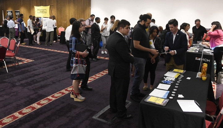 In this June 20, 2018, photo, people attend a job fair in Chicago. A private survey shows that American businesses added 177,000 workers in June, a sign of health and resilience for the U.S. labor market and economy. Payroll processor ADP said Thursday, July 5, that hiring was led by employers with more than 50 workers. (AP Photo/Annie Rice)