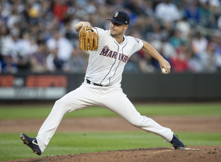 Seattle Mariners starter Wade LeBlanc delivers a pitch during the sixth inning of the team's baseball game against the Los Angeles Angels, Tuesday, July 3, 2018, in Seattle. The Mariners won 4-1. (AP Photo/Stephen Brashear)