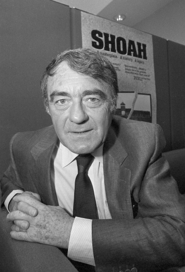 "FILE - In this May 28, 1986, file photo, French filmmaker Claude Lanzmann poses in Los Angeles while discussing his film ""Shoah,"" a 9½-hour epic about the Holocaust widely considered one of the greatest documentary films of all time. Lanzmann died Thursday morning in Paris, according to Gallimard, the publisher of his autobiography. He was 92. (AP Photo/Mark Terrill, File)"