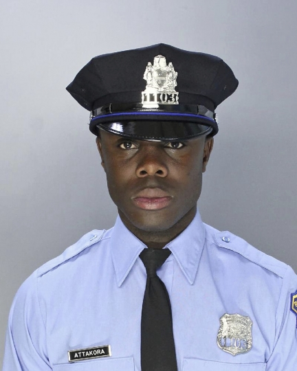 This undated photo provided by the Philadelphia Police Department shows Officer Fred Attakora, who was off-duty when he was shot in his arm and abdomen at a block party on Wednesday, July 4, 2018, in Philadelphia. The shooting at the Fourth of July block party critically wounded Attakora and killed 24-year-old Michael Boateng, of Philadelphia, who was shot in the chest and later died at a hospital, according to the Philadelphia Police Department. (Philadelphia Police Department via AP)