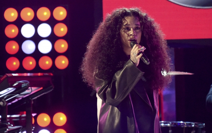 FILE - In this June 24, 2018, file photo, Ella Mai performs at the BET Awards at the Microsoft Theater in Los Angeles. R&B singer-songwriter Ella Mai's meteoric rise up the charts and in fans' hearts brings her to the 2018 Essence Festival in New Orleans. Her performance is scheduled for Saturday, July 7, in one of the Superlounges. (Photo by Richard Shotwell/Invision/AP, File)