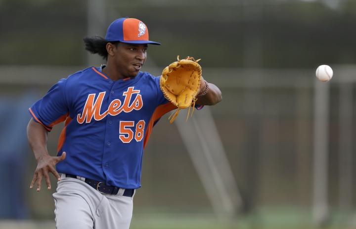 FILE - In this Feb. 21, 2015, file photo, New York Mets pitcher Jenrry Mejia catches a ball during spring training baseball practice in Port St. Lucie, Fla. Mejia has been granted conditional reinstatement from his lifetime drug suspension and could return for the 2019 season. (AP Photo/Jeff Roberson, File)