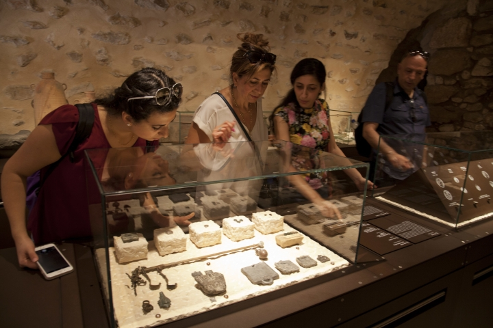 "In this Wednesday, June 27, 2018 photo, visitors look at exhibits, entitled ""The House of Herod: Life and Power in the Age of the New Testament,"" at the Terra Sancta Museum in Jerusalem. Jerusalem's Franciscan friars have opened The Terra Sancta Museum, a new museum in the old city of Jerusalem, filled with artefacts from biblical sites relating to daily life in Jesus' time. (AP Photo/Caron Creighton)"