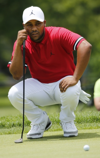 Harold Varner III looks at a putt on the first hole during the third round of the Military Tribute at The Greenbrier golf tournament in White Sulphur Springs, W.Va., Saturday, July 7, 2018. (AP Photo/Steve Helber)