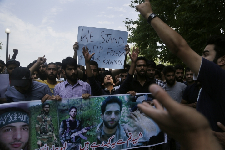 Students shout slogans during a protest inside the Kashmir University campus in Srinagar, Indian controlled Kashmir, Sunday, July. 8, 2018. Armed police and soldiers fanned out across much of Indian-controlled Kashmir to enforce a security lockdown on Sunday as separatists challenging Indian rule called for a shutdown and protests on the second anniversary of the killing of a charismatic rebel leader. (AP Photo/Mukhtar Khan)