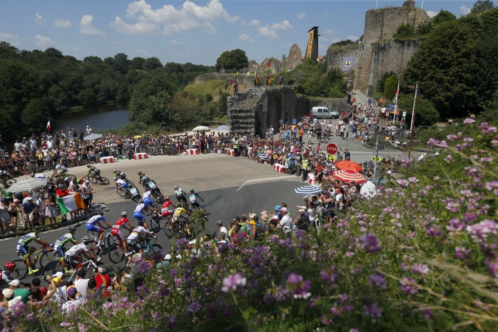 The pack pedals during the second stage of the Tour de France cycling race over 182.5 kilometers (113.4 miles) with start in Mouilleron-Saint-Germain and finish in La Roche Sur-Yon, France, Sunday, July 8, 2018. (AP Photo/Peter Dejong)